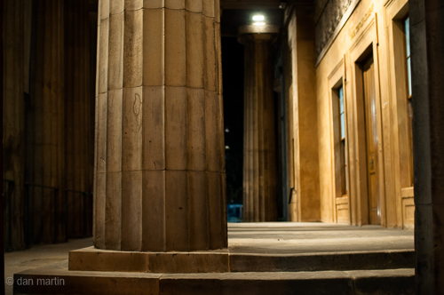 Fluted Greek Columns line the portico