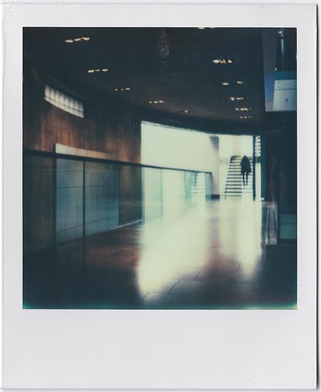 A Figure Decending Polaroid SX-70