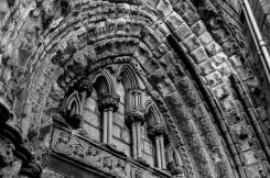 Arched header above entranceway