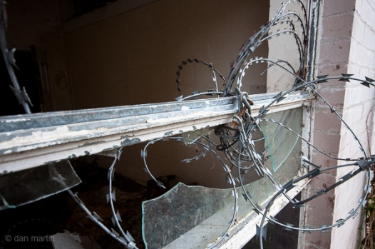 Barbed wire and broken windows