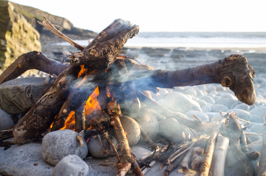 Such warm feelings fire, beach and sea. Content.
