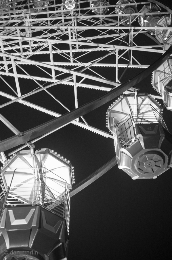 Looking up at a Ferris Wheel