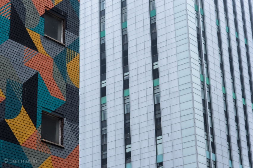 I love the juxtaposition of the coloured building against your typical drab monochromatic city slab.