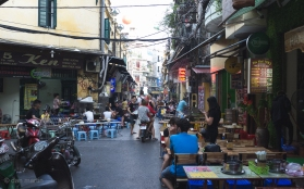Bars down this street with classic Vietnamese plastic stools.