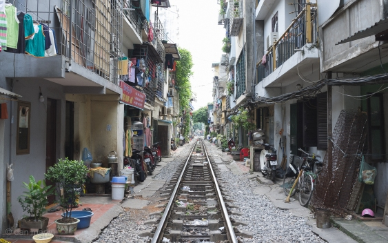 This amazing.. street? lined with houses.. and with a train track running smack down the middle.