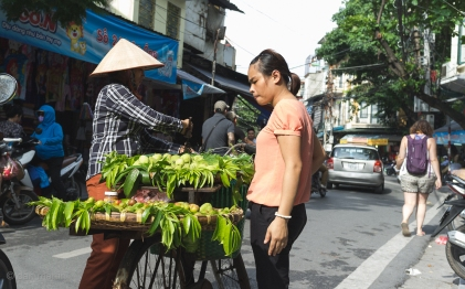 Selling her fruit off the back of her bike.