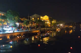 The river at night - with people lighting and floating candles