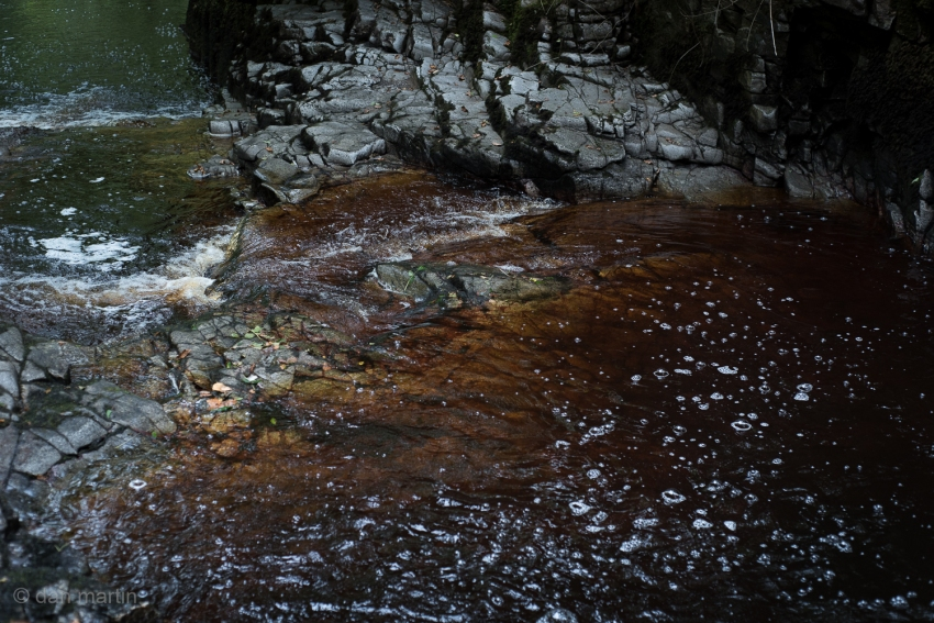 Love the oxide colours in the water against the shape and contrast of the rocks.