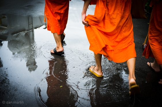Not the most amazing photo, but you have to love the bright orange of the monk's attire against the grey of the tarmac floor.