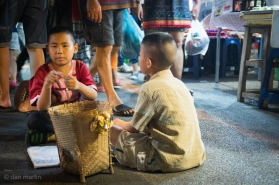 These two kids literally sat right on the floor in between the incredible bustle of the market.